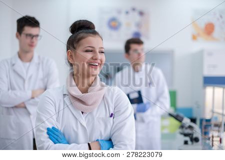 portrait of a group young medical students standing together in chemistry laboratory,teamwork by college student indoors