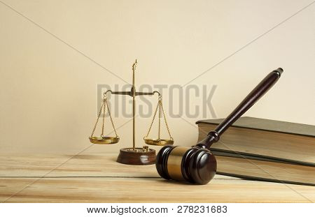 Law Concept. Wooden Judge Gavel, Scales Of Justice And Books On Table In A Courtroom Or Enforcement