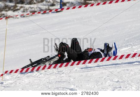 Snow Biker Downhill After Accident In Winter Mountains Tien Shan