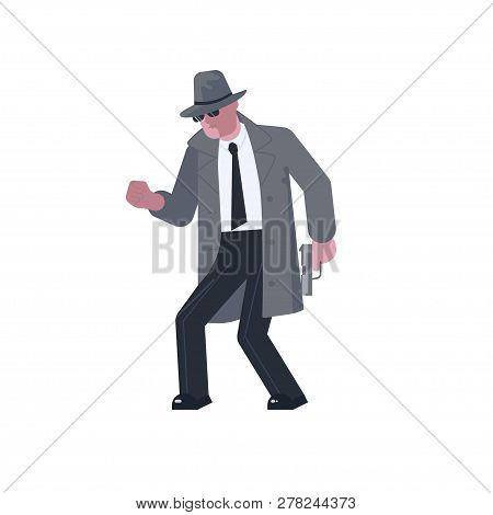 Mysterious Man Wearing A Gray Hat And Coat With A Raised Collar Sneaks With A Pistol Isolated On Whi