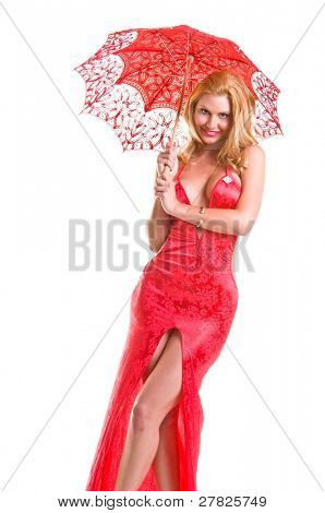 Blond fashion model wearing a low cut  vintage style red dress cut high up the front  carrying a red lace parasol