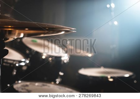 Close-up Drum Set In A Dark Room Against The Backdrop Of The Spotlight. Atmospheric Background Symbo