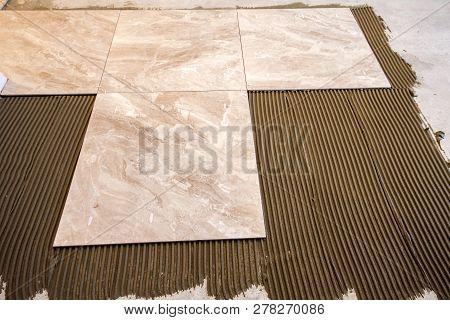 Ceramic Tiles And Tools For Tiler. Floor Tiles Installation. Home Improvement, Renovation - Ceramic