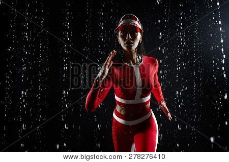 Beautiful Young Girl In Sportswear In Aqua Studio. Drops Of Water Spread About Her Fitness Body. The