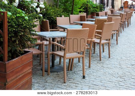 Unoccupied Restaurant Tables On The City Street