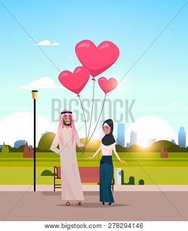 Arab Man Giving Woman Pink Heart Shape Air Balloons Happy Valentines Day Concept Arabic Couple In Lo