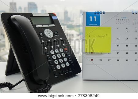 Voip Ip Phone For Conference Call Meeting In November Calendar With Sticky Note Of Appointment Remin