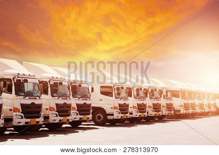 New Haulage Truck Fleet Is Parking Narrow At Yard With Sunset Warm Tone Beautiful Sky.
