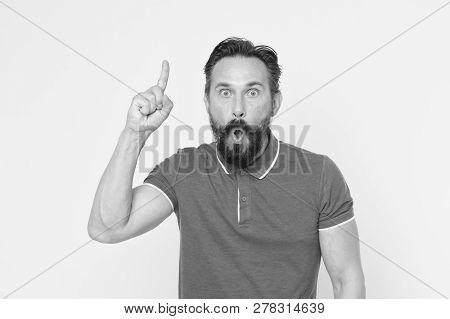 Surprised Man With Open Mouth Keep Finger Pointing Up. Beraded Man Surprised With Epiphany And Sudde