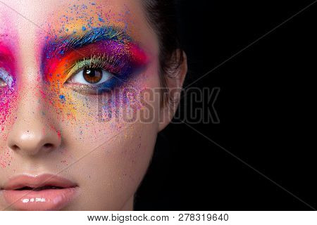 Close Up View Of Female Face With Bright Multicolored Fashion Makeup. Holi Indian Color Festival Ins