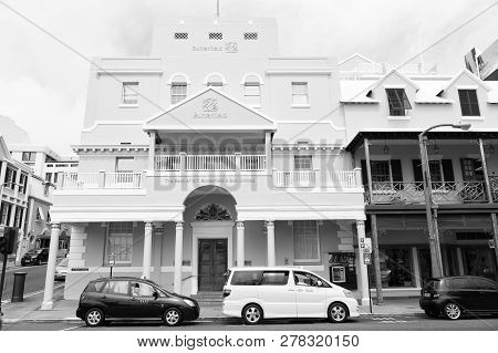 Hamilton, Bermuda - March, 20, 2016: Urban Bank Building. Cars Parked At Urban City Houses On Street