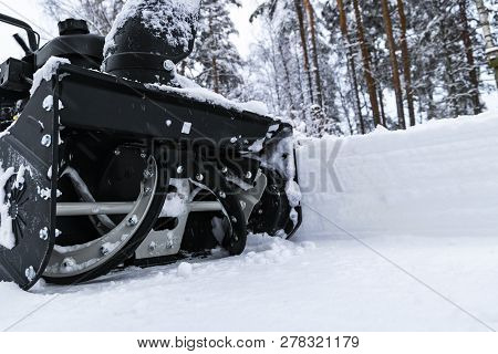Snowblower At Work On A Winter Day. Removing Snow After Blizzard Snowfall. Clearing The Ice. A Snow