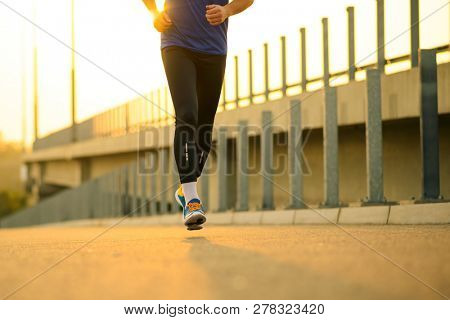 Close-up of Male Sports Mans Legs Running at Sunset. Healthy Lifestyle and Active Sport Concept.