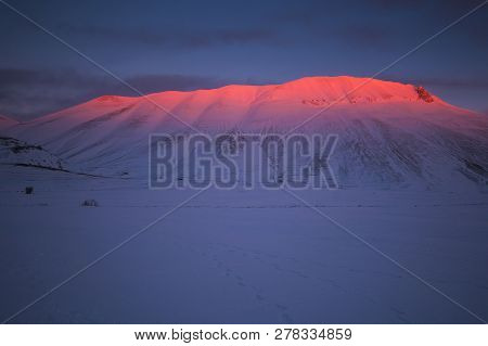 Panoramic View Of Vettore Mountain At Dusk With Snow In The Monti Sibillini National Park