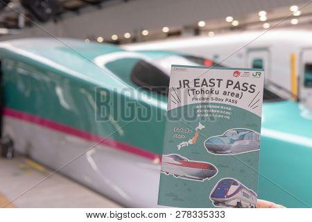Tokyo, Japan - October 24 2018: Jr East Pass (tohoku Area), With The Hayabusa Shinkansen At Backgrou