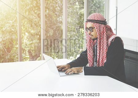 Arabian Business Man Working On Laptop In The Office - Image
