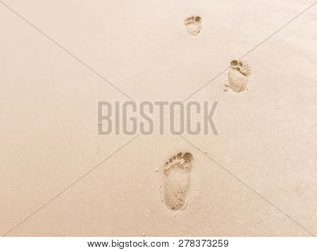 Footprints On Beach Background. Royalty High-quality Stock Photo Image Of Footprint Of Human Feet On