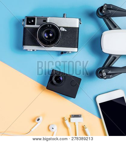 Hi Tech Travel Gadget And Accessories On Blue And Yellow Copy Space