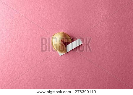 Fortune Cookie With Blank Paper On The Pink Background
