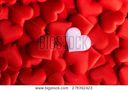 Valentine's Day Background. Holiday Abstract Valentine Background with red satin Hearts. Heart Shape Backdrop. Love concept. Wallpaper