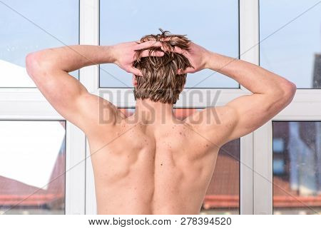 Health and wellbeing concept. Feeling good. Pleasant morning relaxation. Enjoy morning begin awesome day. Macho relaxing in morning bedroom. Macho sexy muscular torso guy relaxing near window bedroom poster