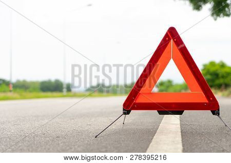 Breakdown Triangle Stands Alongside The Road. Car Broke Down Sign On Road Concept.