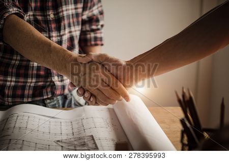 Hand Of Construction Worker Team Contractor Handshake After Finishing Up A Business Meeting To Greet