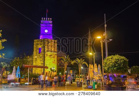 Antalya, Turkey - May 9, 2017: The Ancient Clock Tower, Located In Republic Avenue, Is Decorated Wit