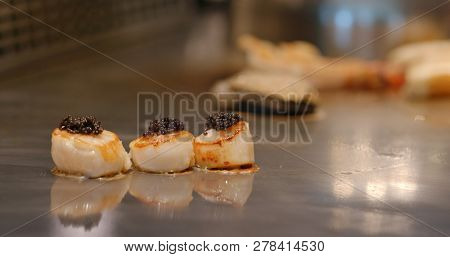Cooking Teppanyaki in restaurant with scallop
