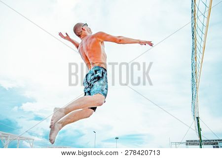 Volleyball Beach Player Is A Male Athlete Volleyball Player Getting Ready To Serve The Ball On The B