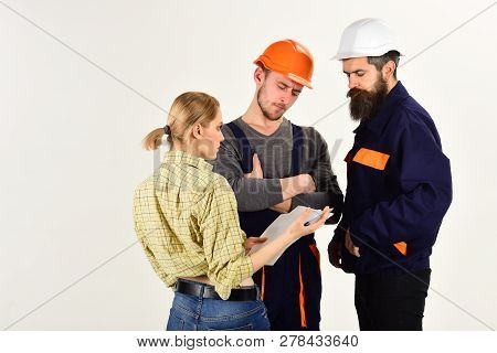 Your Project Is Our Business. Men And Woman Builders Work In Team. Group Of Constructing Engineers O