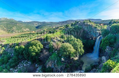 View Of The Saar Waterfall, With Mount Hermon And Nimrod Fortress In The Background, In The Golan He