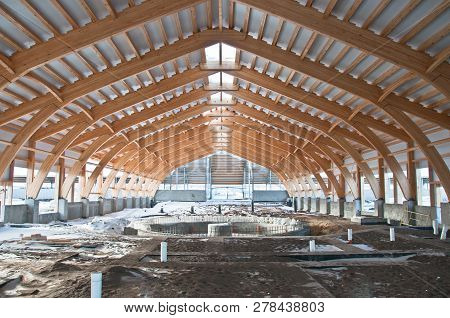 Roof construction of laminated veneer lumber.Building.Glued laminated timber.Building. Construction site HR. poster