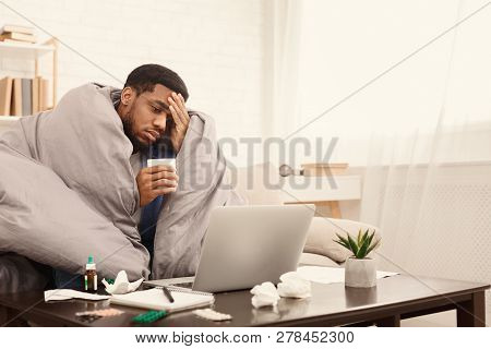 Sick Employee Suffering From Virus But Need To Work, Taking Pills For Flu And Using Laptop At Home,