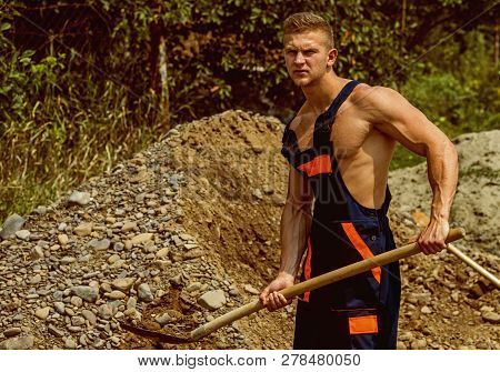Worker Concept. Worker Remove Ground With Shovel. Manual Worker In Working Uniform. Strong Worker Wi