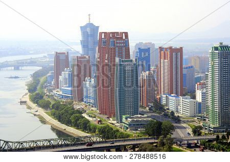 NORTH KOREA, PYONGYANG - SEPTEMBER 25, 2017: Aerial view of new residential complex and Daedong River (Taedong River), capital city of North Korea (DPRK). View from Yanggakdo island
