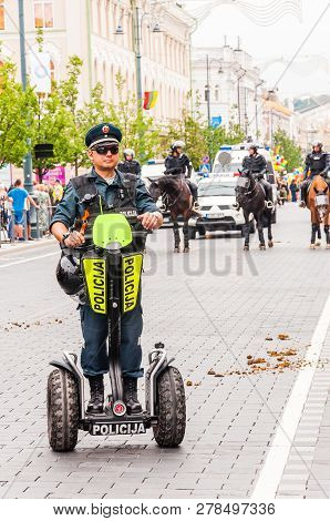 Vilnius, Lithuania - July 27, 2013: Police Officer On Segway Standing At The Beginning Of Pride Para