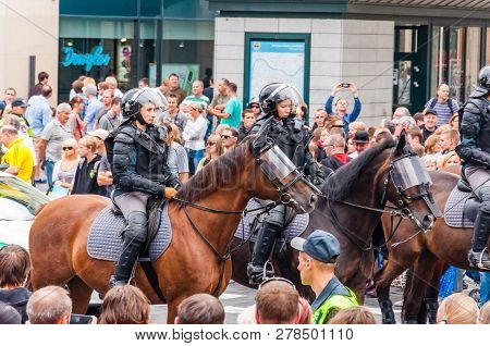 Vilnius, Lithuania - July 27, 2013: Armed Mounted Police Forces Riding At The End Of Pride Parade On