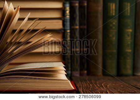 Stack Of Books On Bookshelf, Close-up. Education Learning Concep