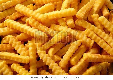 Close Up Background Of Crinkle Cut Fried Chips