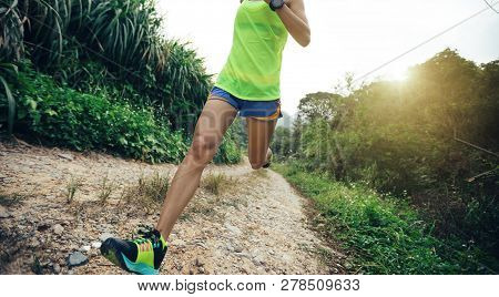 Young Fitness Woman Cross Country Running On Rocky Trail