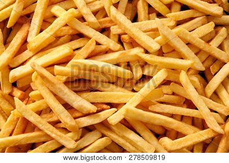 Overhead View Of Golden Deep Fried French Fries Food In Full Frame Closeup.
