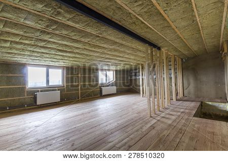 Construction And Renovation Of Big Light Spacious Empty Room With Oak Floor, Walls And Ceiling Insul
