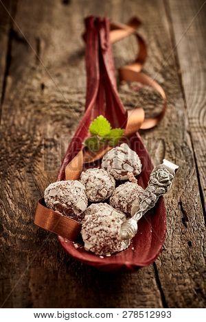Handmade Chocolate Bonbons Displayed In A Leaf