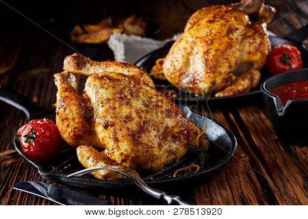 Two Small Roasted Poussin Or Spring Chickens