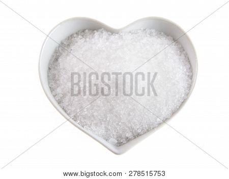 Fleur De Sel In A Heart-shaped Bowl On White