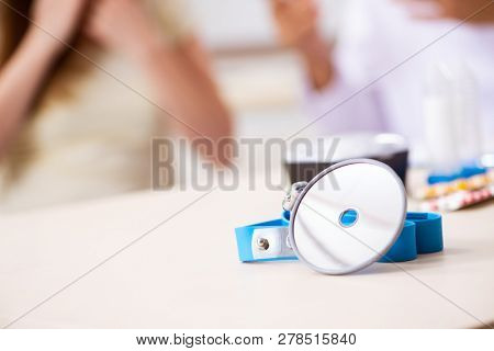 Young woman visting male doctor otolaryngologist