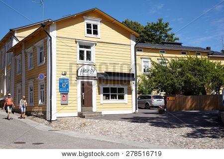 PORVOO, FINLAND - JULY 16, 2017: People at street sign of old town. Porvoo, Borga in Swedish, is one of the six medieval towns in Finland, first mentioned as a city in texts from the 14th century