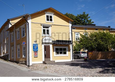 PORVOO, FINLAND - JULY 16, 2017: Street sign of old town on a house. Porvoo, Borga in Swedish, is one of the six medieval towns in Finland, first mentioned as a city in texts from the 14th century