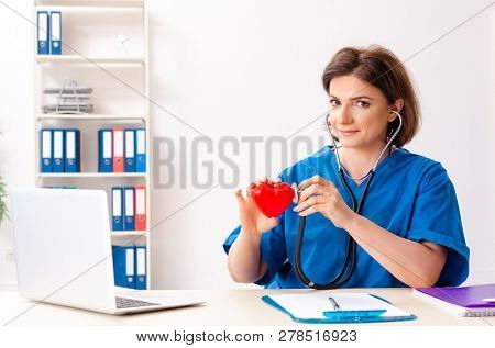Female doctor cardiologist working in the hospital